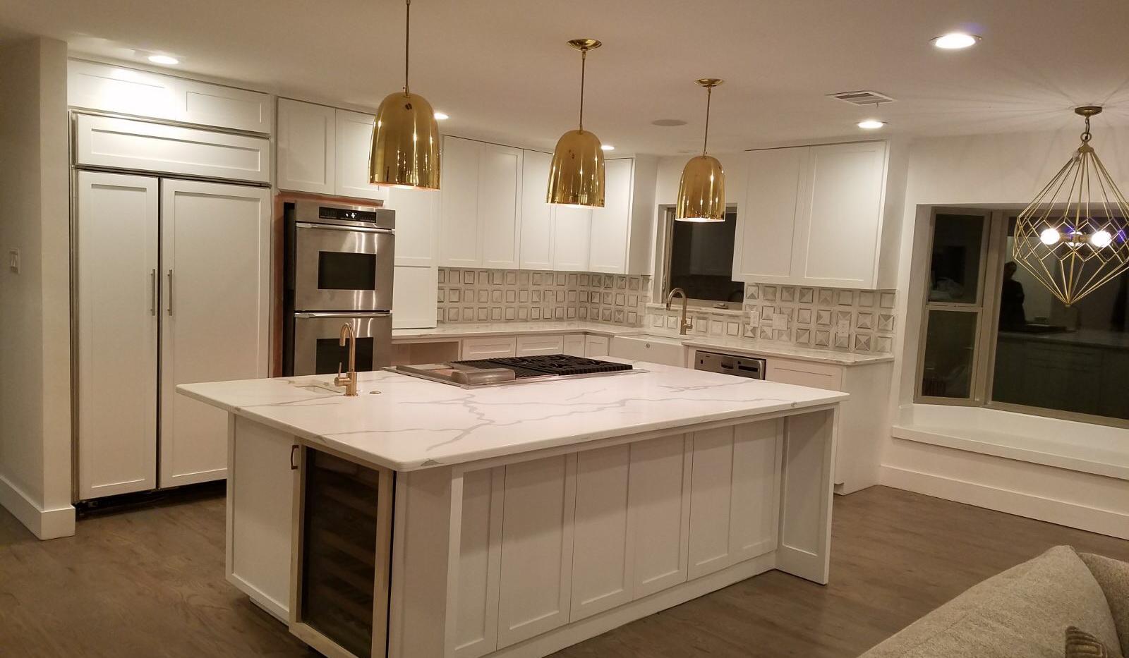White quartz kitchen with gold accents.p