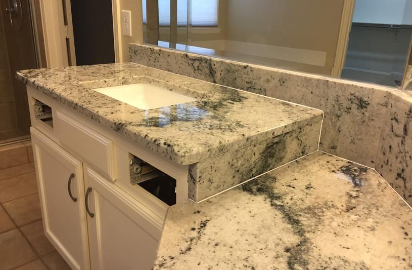 Colonial_white_granite_counterop_bathroo