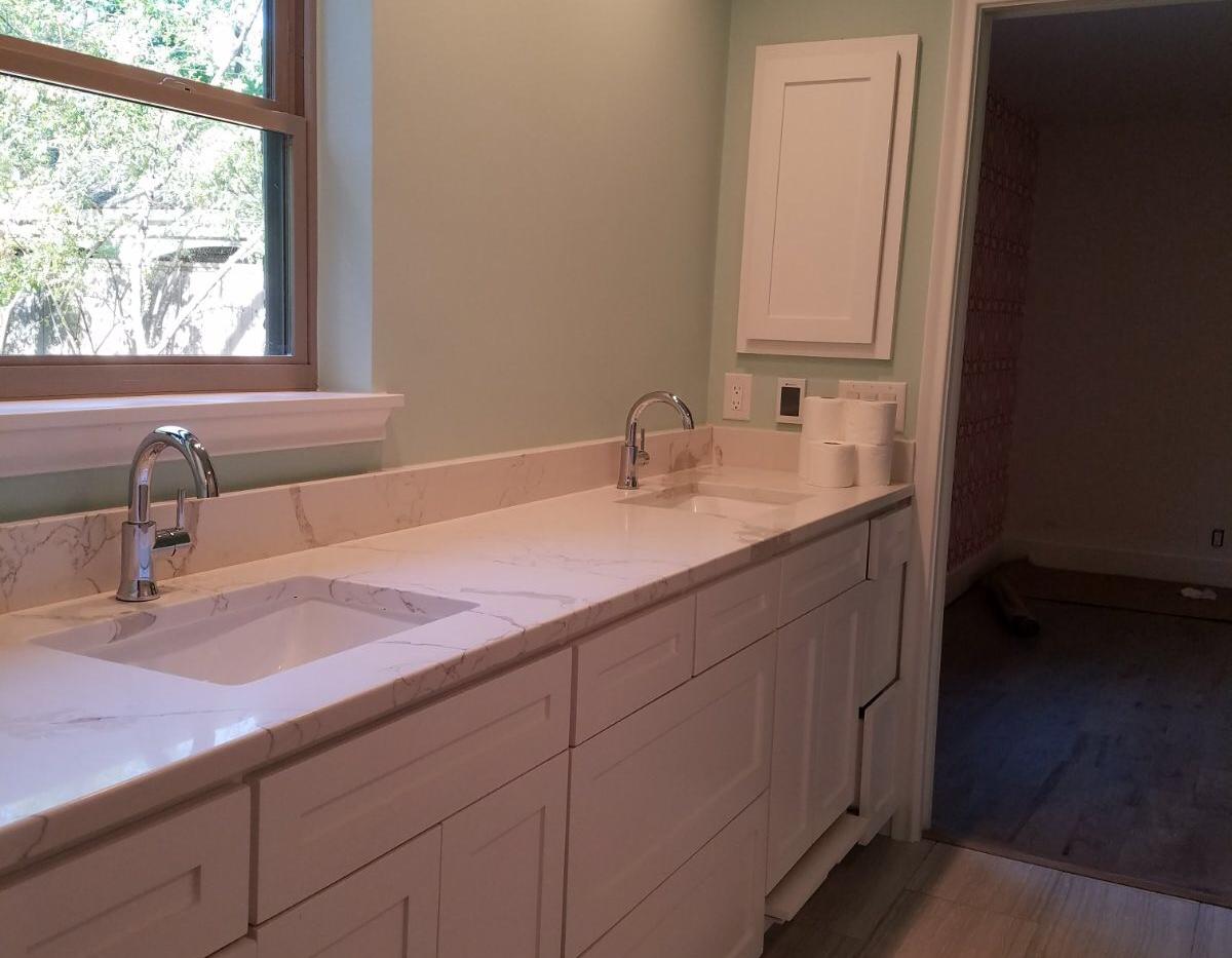 White quartz double sink vanity.png