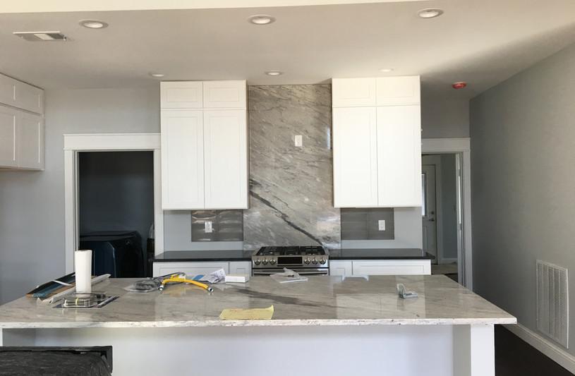 Exotic_gray_marble_backsplash_kitchen_co