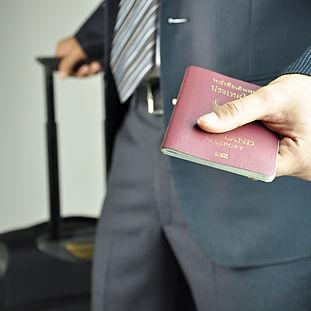Traveling businessman handing passport -