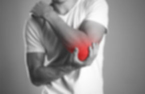 A man holding hands. Pain in the elbow.