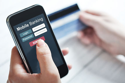 Female hands using mobile banking on sma