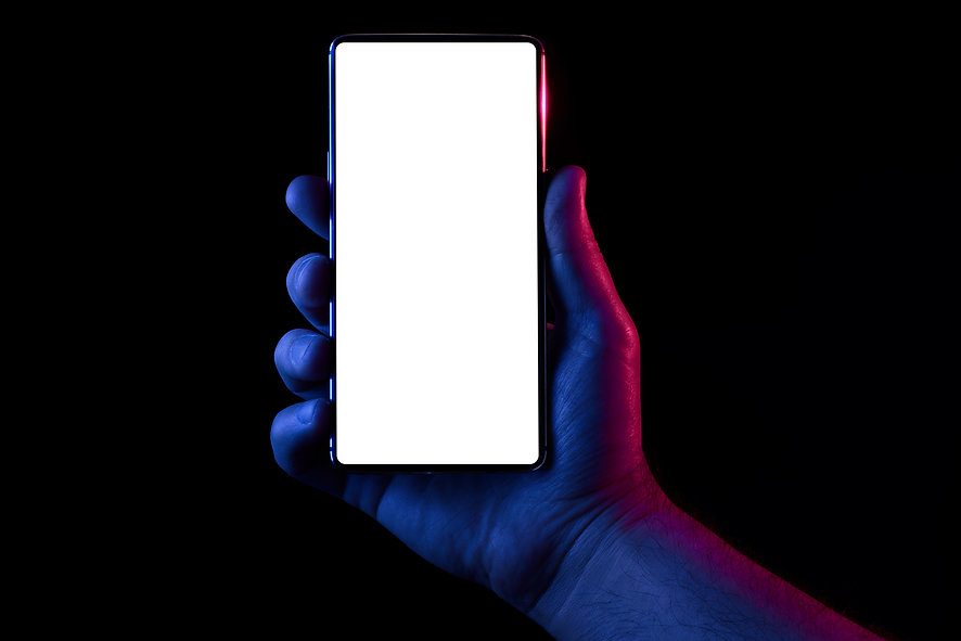 Phone in hand. Silhouette of male hand l