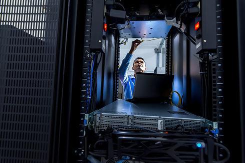 Network administrator working in data center room.jpg