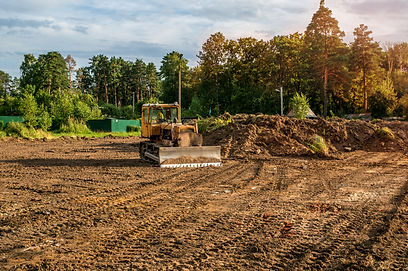 The excavator cleared the land leaving t
