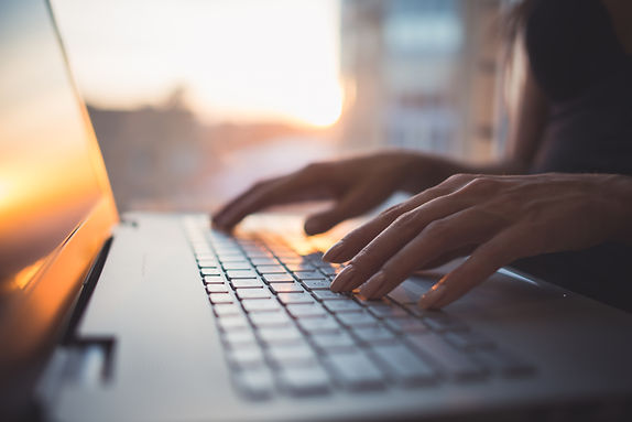 Woman working at home office hand on keyboard close up.jpg