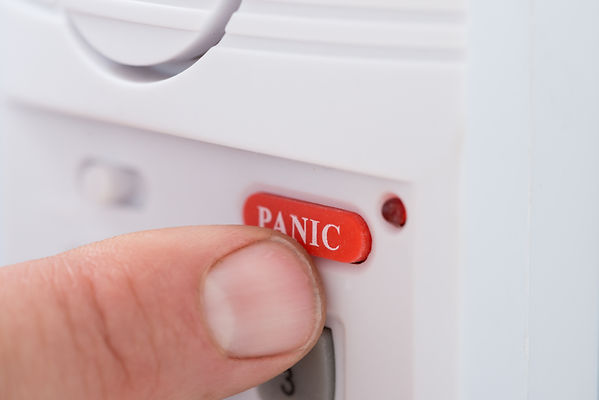 Close-up Of Person's Hand Pressing Panic