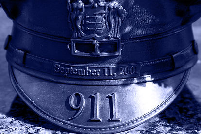 Close-up photo image of belt with September 11, 2001 printed on it.
