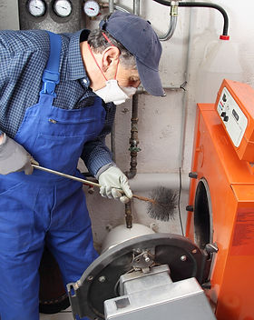 A specialist doing Boiler cleaning.jpg