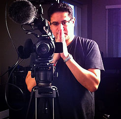 Owner of WideAngle Studios standing behind camera.