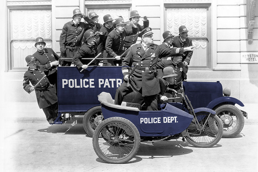 Historical photo with large number of policemen on a car