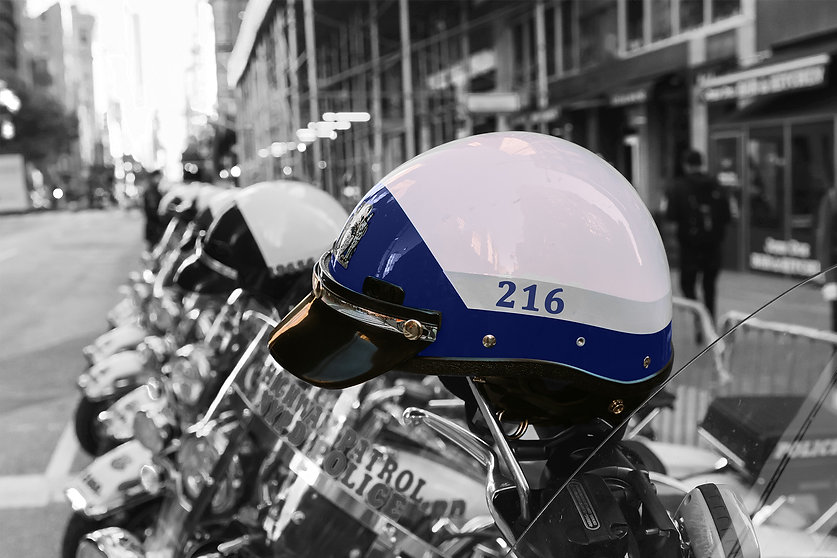 Line of motorcycles in background with New York City motorcycle police helmet in the foreground