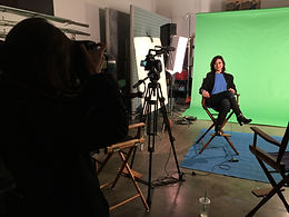 Video production of an interview on a green screen.