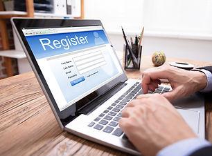 Businessman's Hand Filing Online Registr