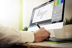 designer designing a logo. All screen gr