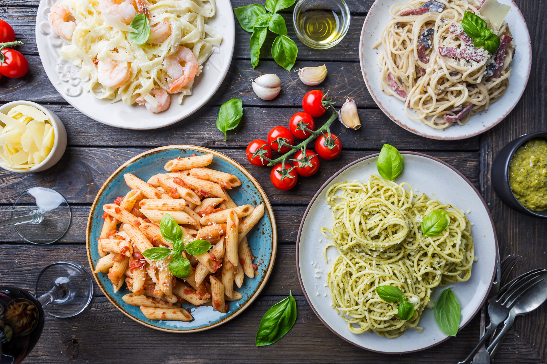 Several plates of pasta with different k