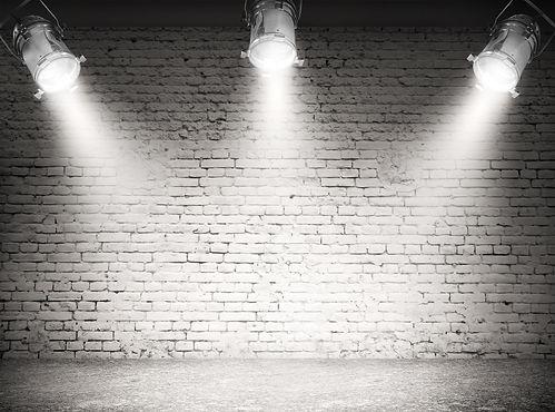 Dark background with spotlights .jpg