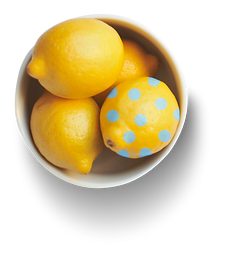 TheLemonadeBar-bowl-with-four-yellow-lemon-one-of-the-lemons-has-blue-dots-painted-bow-has-a-drop-down-shadow