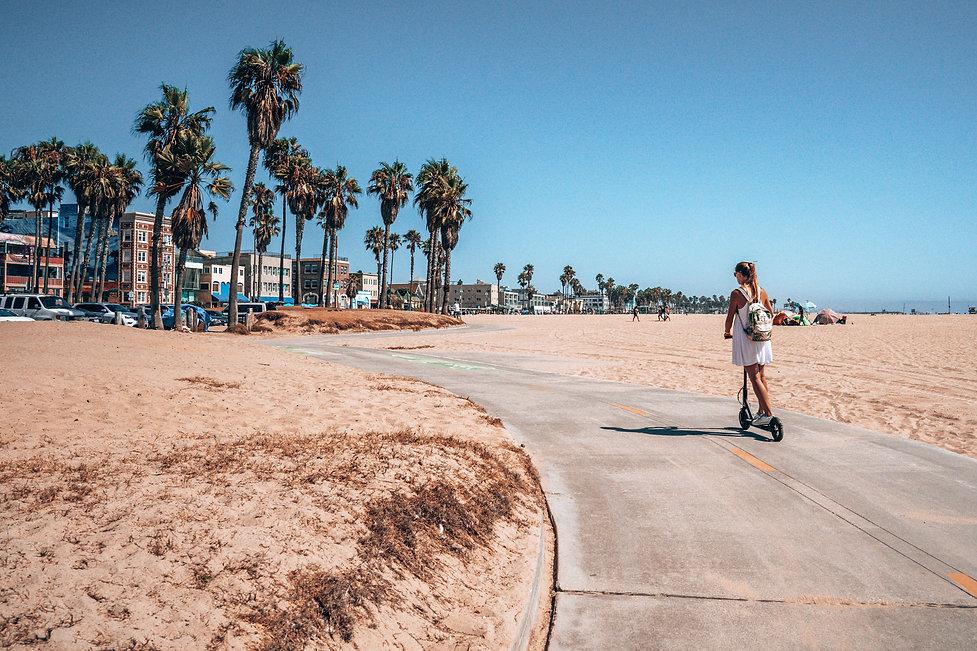 scooter-woman-beach.jpg