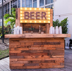 reclaimed wood bar beer tap wall marquee