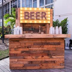 reclaimed wood bar beer tap wall marquee