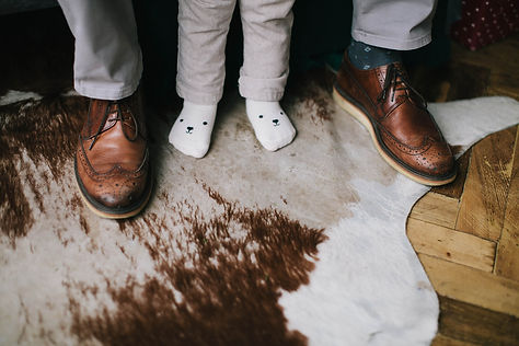Canva - Child Wearing Socks Standing Bet