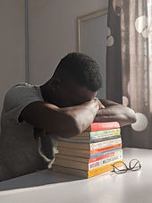 Canva - Man Napping on Books.jpg