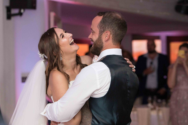 Laughing on first dance