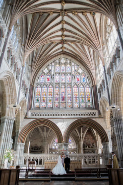 Couple at altar at Exeter Cathedral