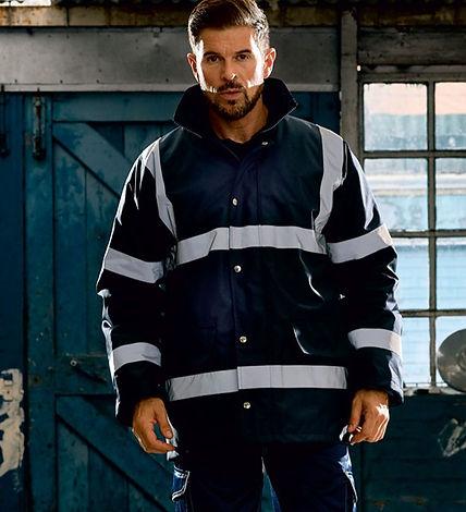 Man wearing black workwear jacket with hi vis stripes