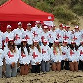Group of people wearing GB Surf Live Saving white printed hoodies