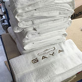 Pile of towels with Gaya Superyacht logo embroidered