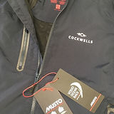 Dark jacket with Cockwells logo embroidered