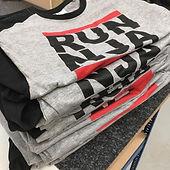 Pile of grey printed t-shirts