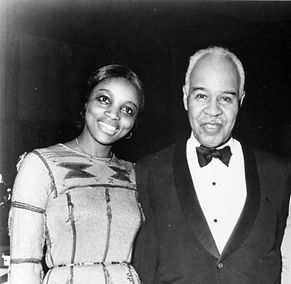 Dr. Glory and Roy Wilkins, former director of the NAACP, at his retirement banquet (1977).