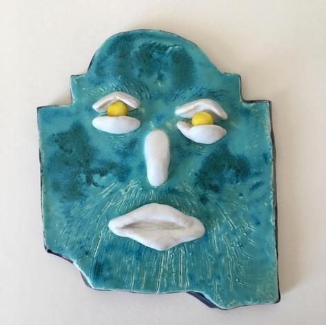 blue face wall tile