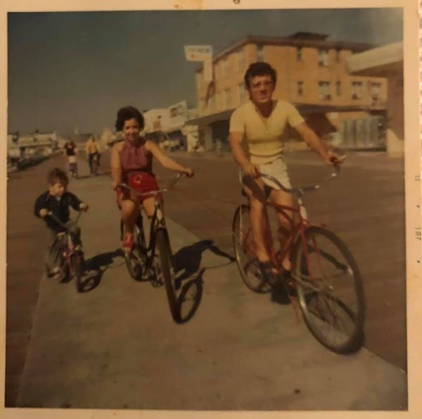 Mom, Dad and Paul on bikes in OC