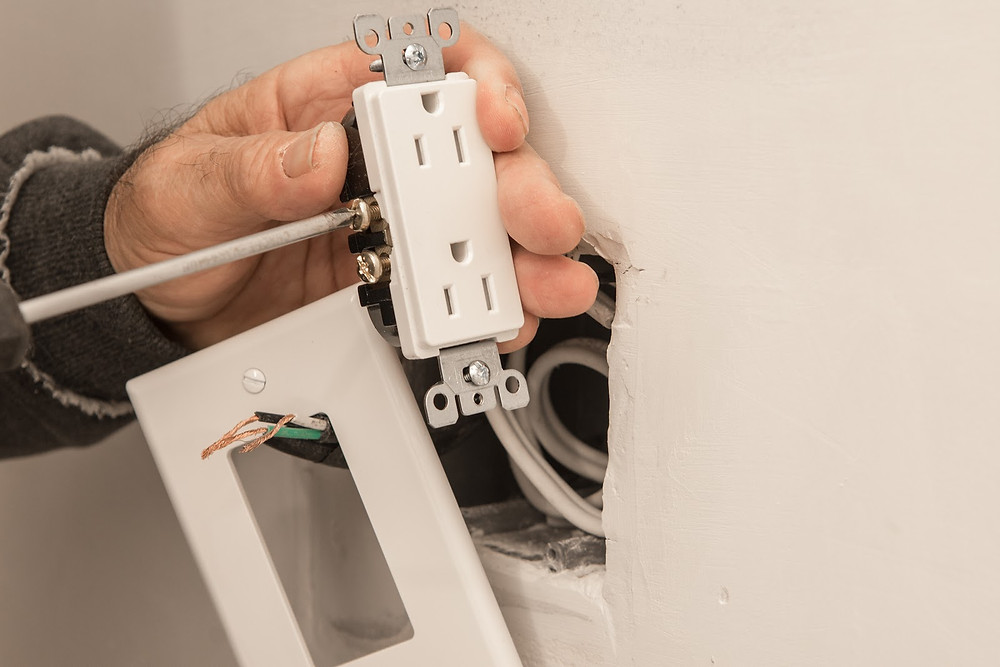 Person sealing electrical outlet