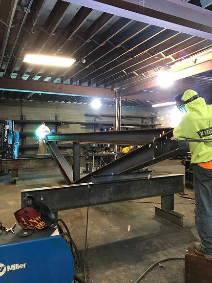 Workers welding in shop at JM Welding Inc. Co