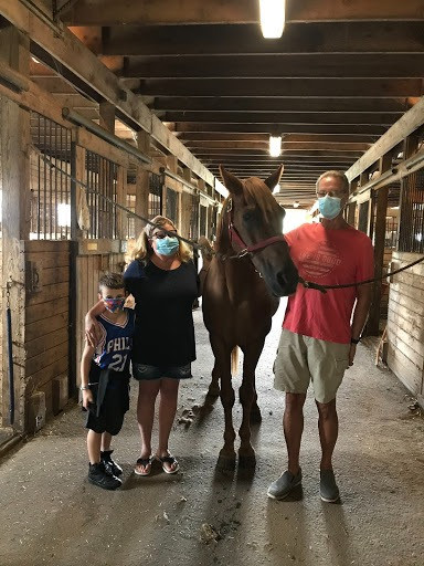 Family with their sponsored horse