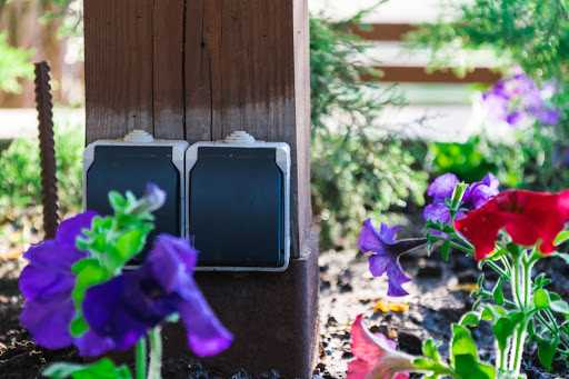 Outdoor outlets surrounded by flowers
