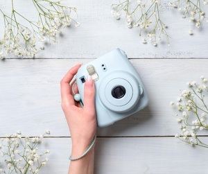 Placing disposable cameras or polaroid cameras on each of your guest tables will add an incredible fun-loving aesthetic to your wedding.