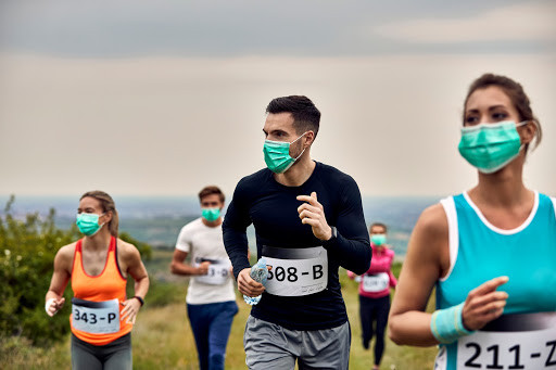 People running in a race with masks on