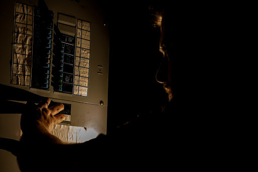 Man in dark checking breakers