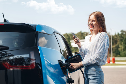 Girl charging electrical car