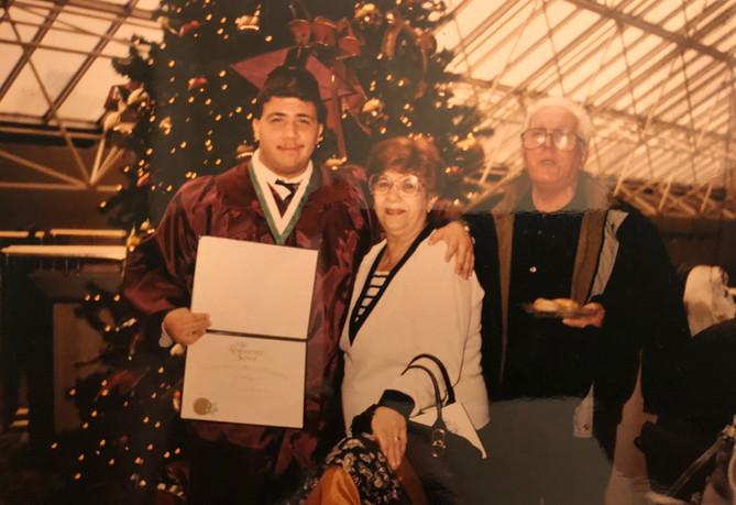 Paul graduating culinary school with grandparents