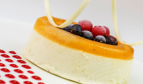 Passion fruit mousse with forest fruits.