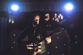 Ash Francis acoustic wedding singer playing guitar.