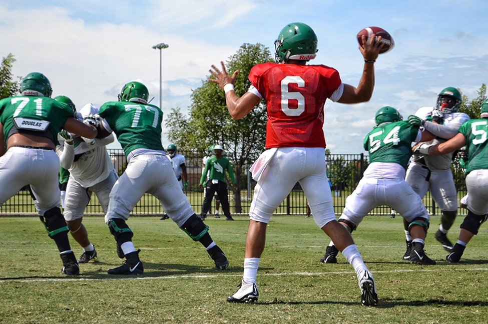 Fine throwing behind his offensive line in summer practice.